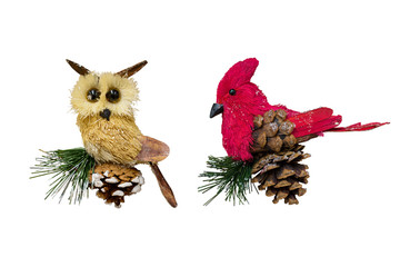 Christmas and New Year decorations: figurines of toy owl and northern cardinal. Isolated, white background.