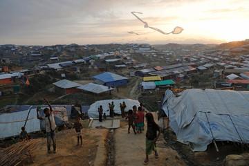 Rohingya refugee children fly improvised kites at Kutupalong refugee camp near Cox's Bazar