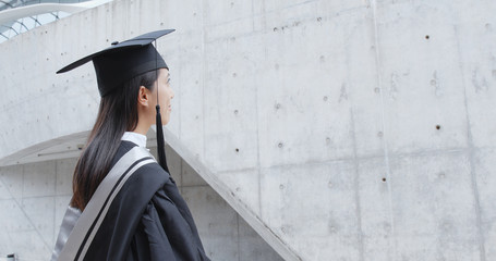 Woman think of the future after graduation