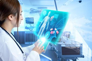 Female doctor operating futuristic medical interface.