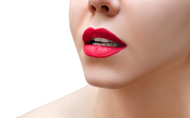 Red lips. Female face closeup.
