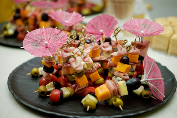 Canapé of fruits and meat at the banquet