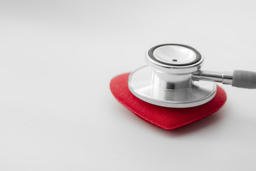 Stethoscope over red heart
