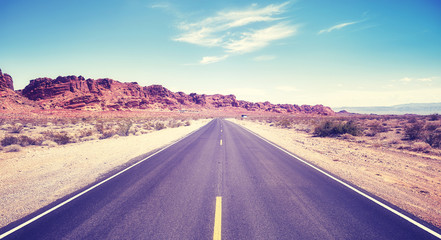 Vintage toned desert road, travel concept picture, Valley of Fire State Park, Nevada, USA.