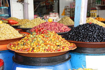 Piickled olives and pepper on a traditional Moroccan market, Rabat, Morocco