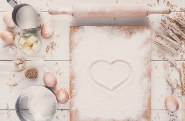 Love baking background, flour with drawn heart