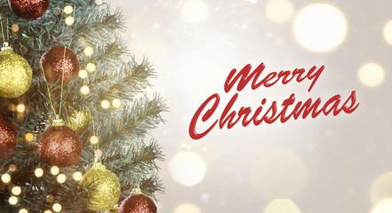 Closeup of Christmas tree with Merry Christmas sign