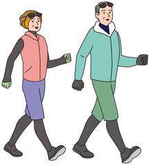 冬の服装でにウオーキングする中年夫婦