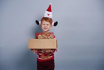 Happy boy holding gift box