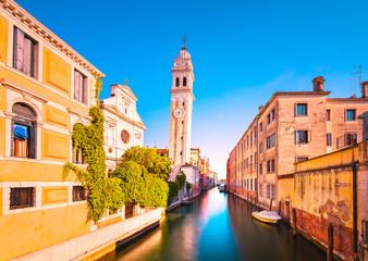 Venice sunset in San Giorgio dei Greci water canal and church campanile. Italy