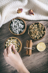 Arranging Herbal Teas On A Wooden Surface