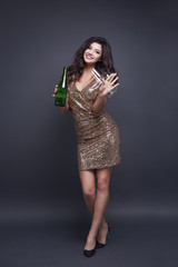 Full length portrait of woman with champagne flute and bottle