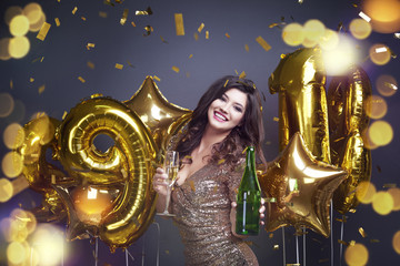 Happy elegant woman offering champagne .