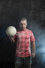 Studio portrait of sportsmen using balls