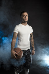 Studio portrait of sportsmen using balls