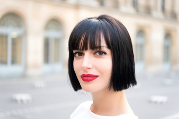 Woman or girl with red lips in paris, france