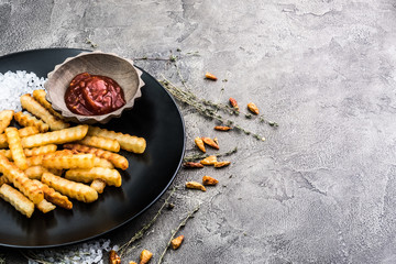 Deep fried french potatoes on dark background