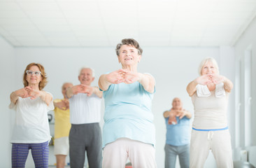 Athletic senior people stretching