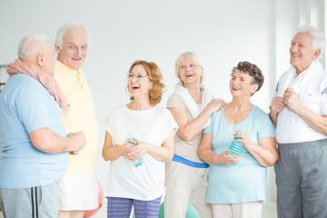 Smiling senior friends in sportswears