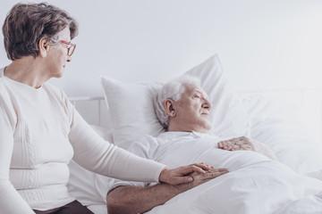 Caring senior woman and husband