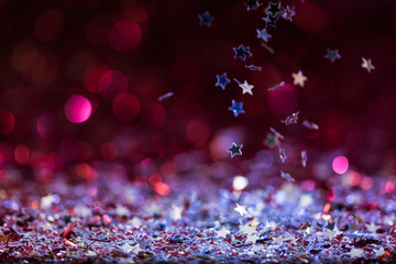 christmas background with falling pink and silver shiny confetti stars