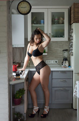 Beautiful sexy woman in the kitchen