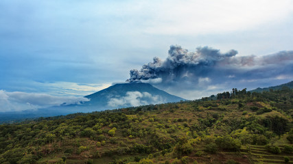 Mount Agung erupting plume. During volcano eruption thousands of people was evacuated from dangerous zone. Airline flights to Bali were canceled, Denpasar airport closed because of volcanic ash clouds
