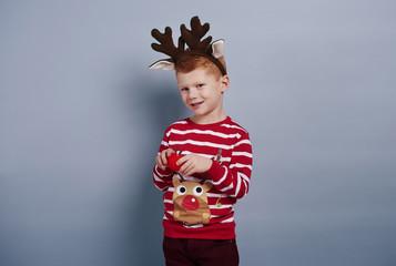 Cute boy looks like reindeer