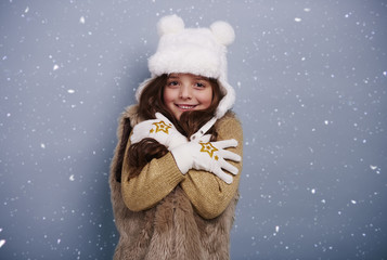 Cute girl shivering with cold