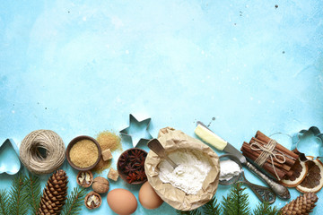 Rustic christmas baking background with ingredients for making cookies or cake .Top view with space for text.