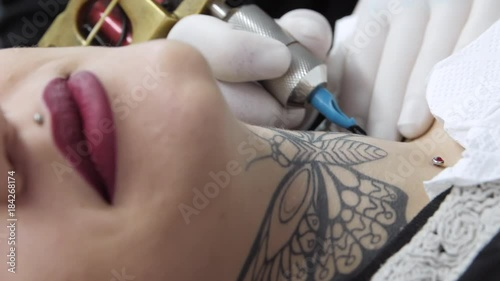 Tattooing On A Beautiful Woman S Neck Butterfly Tattoo In