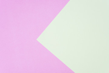 Flat lay, pink and green paper pastel colors for texture background.