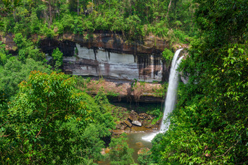 Beautiful Huay Luang waterfall in green forest in jungle, Ubon Ratchathani, Thailand.