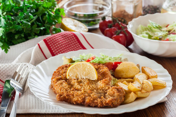 Breaded viennese schnitzel with baked potatoes