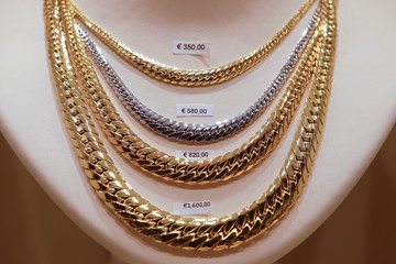 Gold necklaces are seen in a jewellery shop in downtown Rome