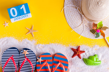 January 1st. Image of january 1 calendar with summer beach accessories and traveler outfit on background. Winter like Summer vacation concept