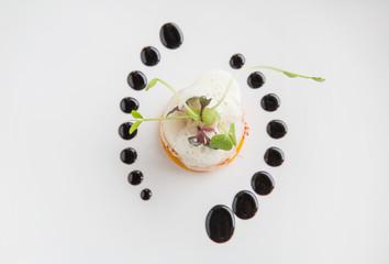 Haute high end cuisine gourmet appetizer shrimp, pear, pumpkin with butter foam