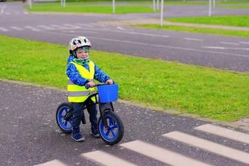 Little child training on traffic playground on pushbike