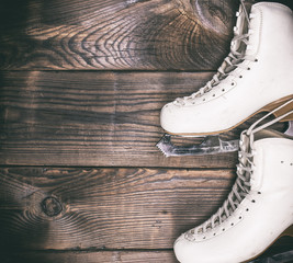 a pair of white leather skates