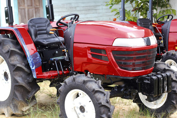 New red agricultural tractor