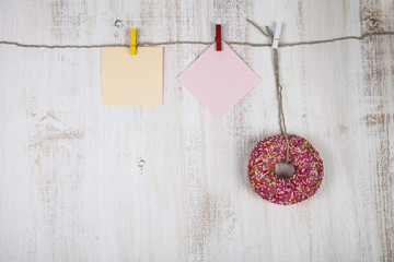 Pink donut and a piece of paper