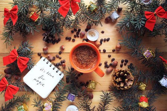 Christmas card with a cup of coffee, notepad and deer antlers. New Year /