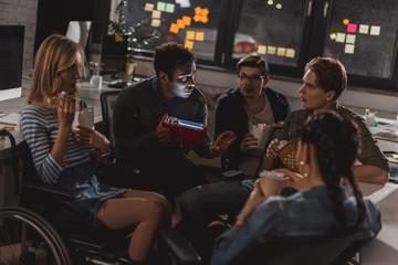 young people spending time together after work at modern office