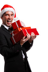 Photo of man in business suit, Santa hat with gifts in boxes
