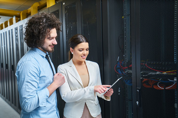 Young couple working at a data center