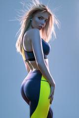 Woman in sport wear posing at camera