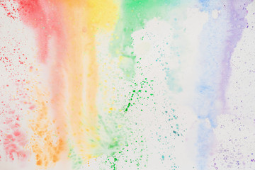 Abstract watercolor stains, iridescent texture in colorful shades of vivid bright colors on white paper, rainbow. Current watercolor
