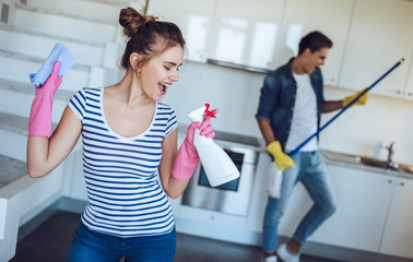 Couple is doing cleaning at home