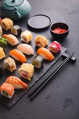 Sushi and rolls background, japanese cuisine