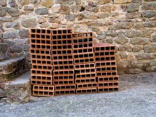 Mediterranean terracotta floor bricks, tiles. Piled into heap.